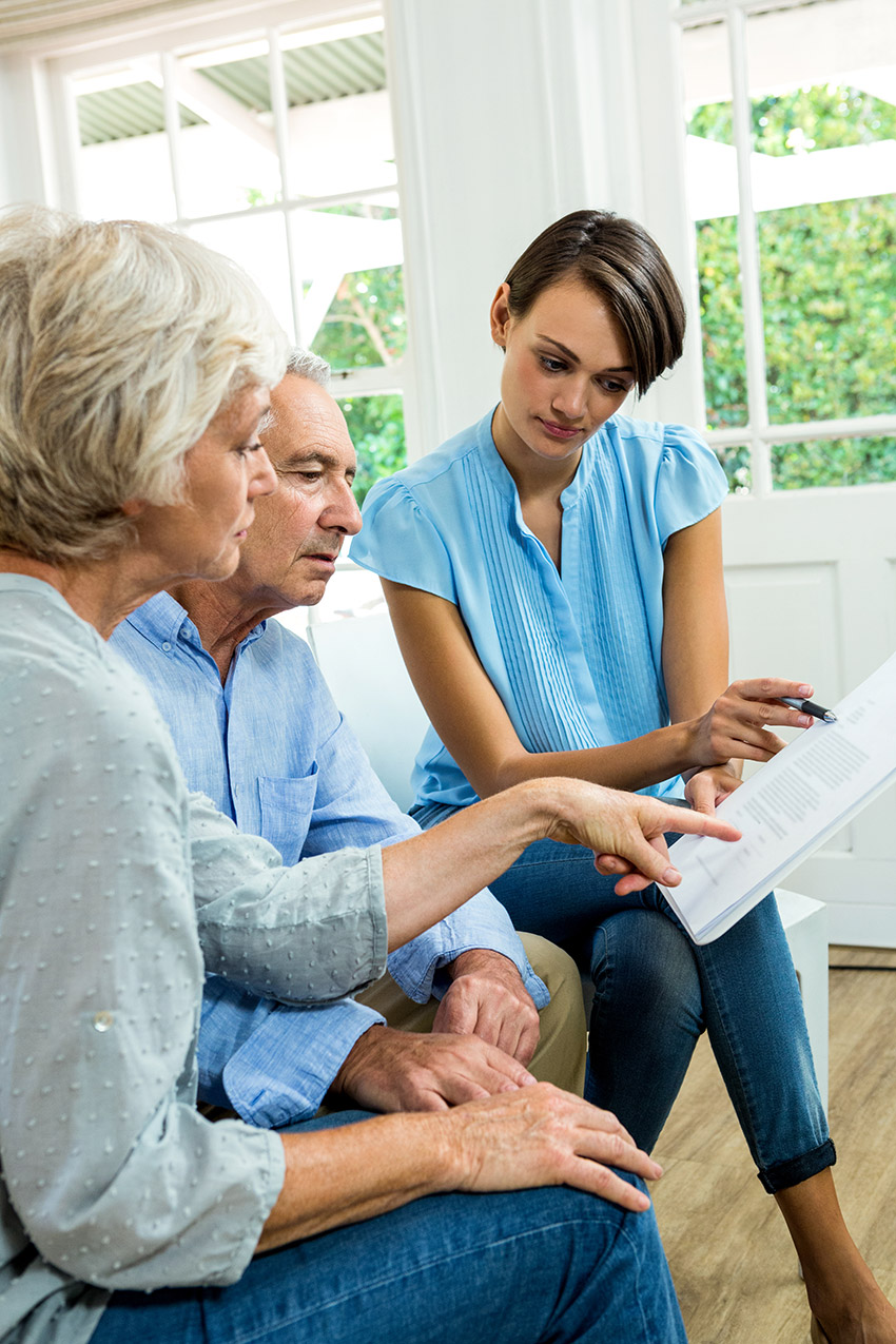 photo of a family reviewing an estate plan and will created by an Edmonton wills and estate lawyer from Safi Law Group
