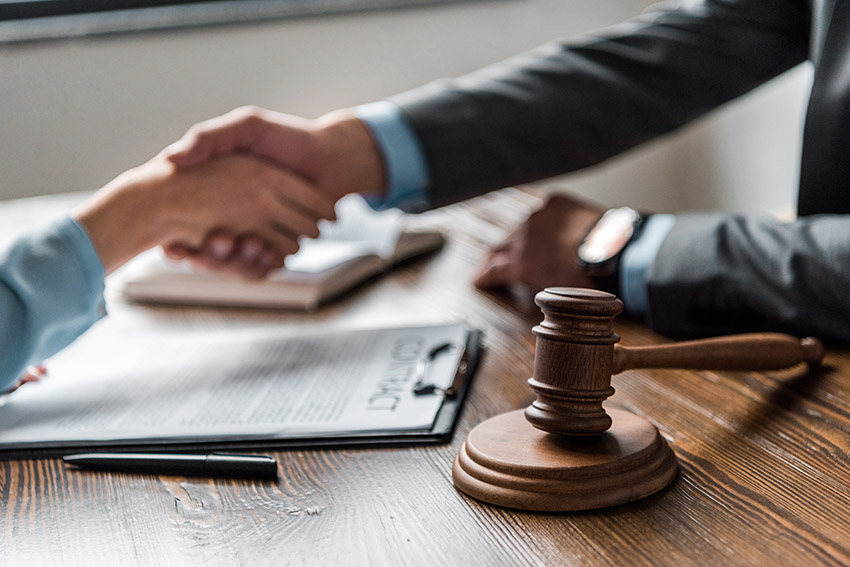 photo of a civil litigation lawyer shaking hands with his client after successfully litigating and winning a case, a service and result you can work to achieve with the help and experience of Safi Law Group, experienced in civil litigation and motor vehicle accident claims