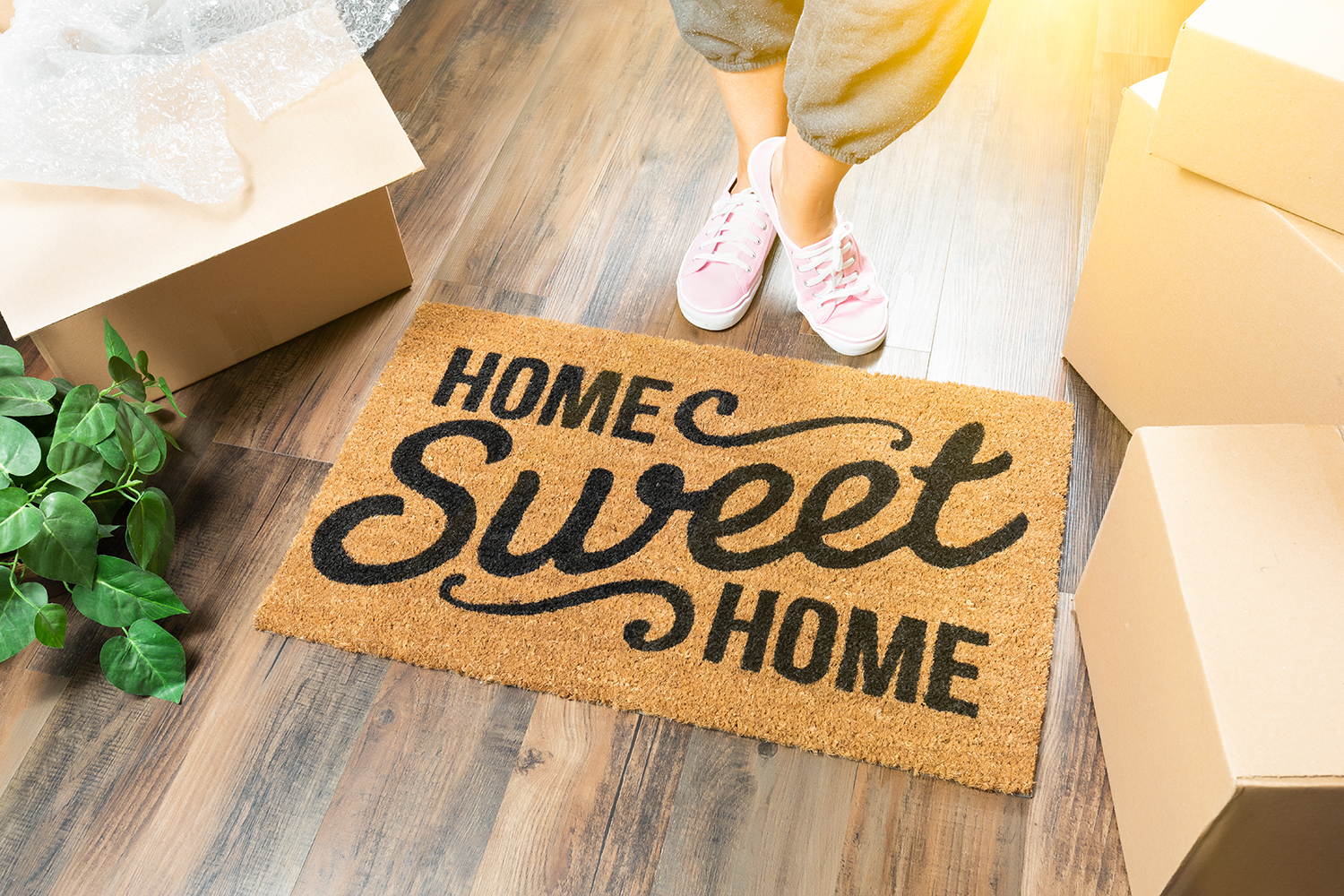 photo of a welcome mat with the message Home Sweet Home, symbolizing a new home purchase, done with the help of an experienced real estate lawyer