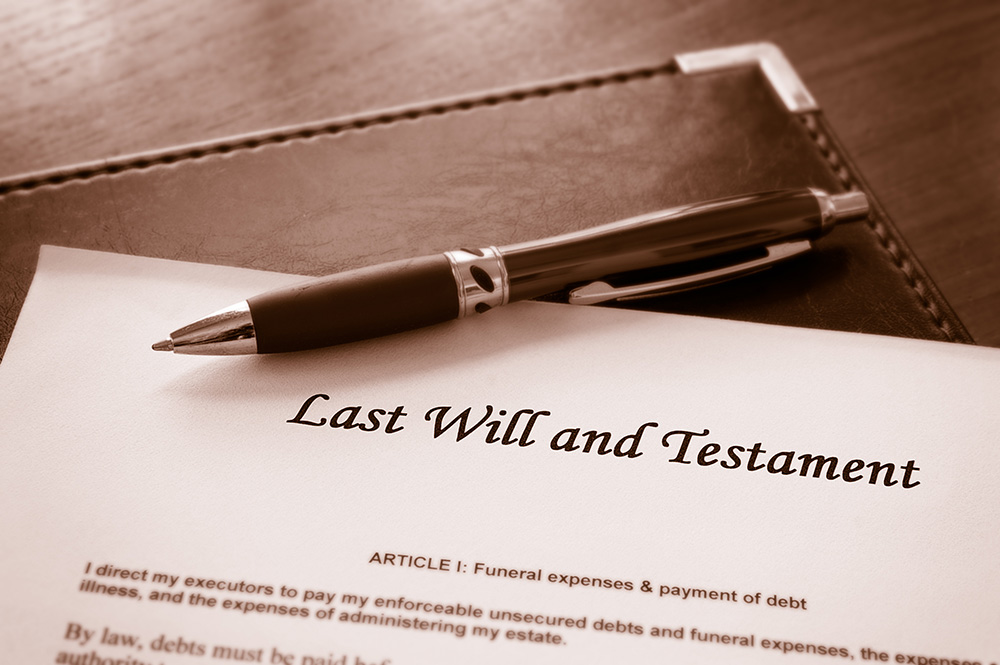 photo of a will being signed, a wise move to protect your assets and children, a service offered by Safi Law Group in Edmonton Alberta