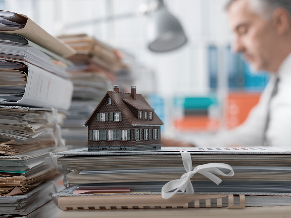 photo of a Real Estate lawyer's desk, a common place to find a Real Estate lawyer or legal assistant working on a number of aspects of a real estate purchase or sale for a client